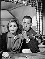 A Night in Casablanca - Casablanca Man in Suit and Woman in Trench Coat