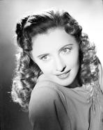 Barbara Stanwyck - Barbara Stanwyck Close Up Portrait in Side View