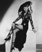Barbara Stanwyck - Barbara Stanwyck Cross Legs sitting Classic Portrait