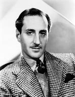 Basil Rathbone - Joan Blondell on an Embroidered Top and sitting