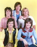 Bay City Rollers - Bay City Rollers Group Picture in Yellow Background