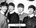 Beatles - Beatles Group Picture with Paul McCartney Holding a Guitar