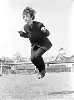 Beatles - Beatles Ringo Starr Jumping with Legs Together in Black Suit and Pants