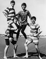 Beatles - Portrait of the Beatles Posed on Beach with Striped Swimsuits