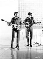 Beatles - Beatles Paul McCartney and George Harrison on Guitars singing on Reflective Floor Stage in Black Suit