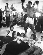 Beatles - Beatles on the Boxing Ring with Muhamamd Ali standing in Boxing Gloves and Shorts