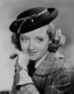 Bette Davis - Bette Davis Portrait in Flat Top Hat with Chin Leaning on Hand in Checkered Suit and Black Tie