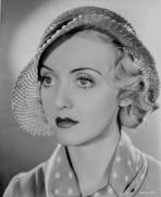 Bette Davis - Bette Davis Portrait in Round Straw Hat and White Polka Dot Necktie and Silk Dress