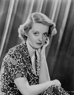 Bette Davis - Bette Davis Portrait Hand on the Cheek in Floral Pattern Dress and Short Curls