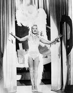 Betty Grable - Betty Grable Posed with Hands Raised Up in Fur Headdress in White Sexy Strap Dress with Fur Bottoms