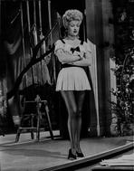 Betty Grable - Betty Grable Posed with Arms Crossed in White Ruffle Dress with Black Ribbon and Black Shoes