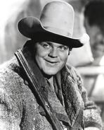 Bonanza - Bonanza in Cowboy Outfit with Rifle in Black and White Portrait