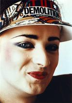 Boy George - Boy George Woman's smiling wearing Sun Visor Cap Close Up Portrait