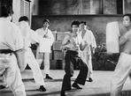 Bruce Lee - Bruce Lee wearing Black Pants in Action