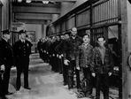 Charlie Chaplin - Group of People Fall in Line With Charlie Chaplin at Prison Cell
