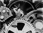 Charlie Chaplin - Charlie Chaplin sitting on Big Metal in Modern Times Movie Scene