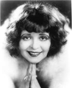 Clara Bow - Clara Bow smiling in Fur Dress with Hand Below Chin Portrait