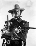 Clint Eastwood - Clint Eastwood Posed in Cowboy Attire with Two Pistol