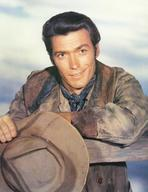 Clint Eastwood - Clint Eastwood Leaning on Fence, wearing Cowboy Attire