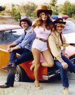 Dukes of Hazzard (TV) - Dukes Of Hazzard Leaning on Car Group Picture with Cowboy Hat