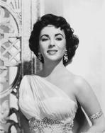 Elizabeth Taylor - Elizabeth Taylor smiling in Dress with Earrings