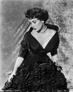 Elizabeth Taylor - Elizabeth Taylor Posed in Gown with Necklace and Earrings