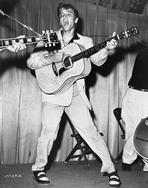 Elvis Presley - Elvis Presley singing and Playing Guitar in Coat