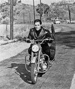 Elvis Presley - Elvis Presley Riding in Classic