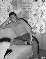 Elvis Presley - Elvis Presley Leaning on Bed Black and White