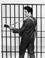 Elvis Presley - Elvis Presley Looking Back and Playing Guitar in Classic