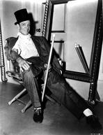 Fred Astaire - Fred Astaire Seated on Chair in Black and White Portrait