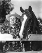 Gene Autry - Gene Autry Leaning on Fence with a Horse