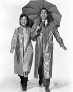 Gene Kelly - Gene Kelly in Raincoat Group Picture