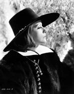 Greta Garbo - Greta Garbo Facing Side Ways Posed wearing Fur Outfit with Black Hat