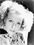 Greta Garbo - Greta Garbo Red lipstick Curly Hairdo wearing Classic Dress
