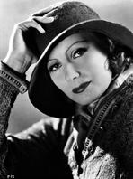 Greta Garbo - Greta Garbo Posed wearing Jacket with Hat Portrait