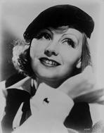 Greta Garbo - Greta Garbo Posed smiling in Black Cap