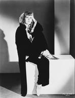 Greta Garbo - Greta Garbo sitting in Black Coat Portrait