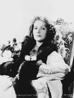 Greta Garbo - Greta Garbo Posed Siting on Chair in Classic Outfit