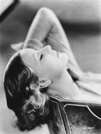 Greta Garbo - Greta Garbo Curly Hairdo Lying on Bench