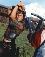 Heath Ledger - Heath Ledger wearing a Vest with Sword in a Fighting Scene