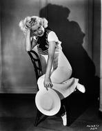 Jean Harlow - Jean Harlow Seated in White Dress and Hat