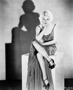 Jean Harlow - Jean Harlow Posed in Gored Skirt Strap Dress and Black High Heel Shoes with Legs Crossed