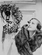 Joan Crawford - Joan Crawford Looking at the Wreath in a Classic Portrait