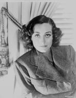 Joan Crawford - Joan Crawford wearing a Thick Coat in a Classic Portrait