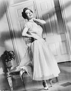 Joan Crawford - Joan Crawford wearing a Cap-Sleeve Dress with a Necklace in Classic