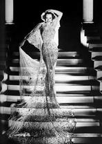 Joan Crawford - Joan Crawford wearing a Long Gown while on the Stairs in a Classic Portrait