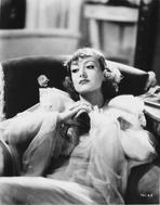 Joan Crawford - Joan Crawford Relaxing on the Couch in Classic