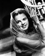 Judy Garland - Judy Garland wearing a Cloak and Holding the Staircase in the Ziegfeld Girl 1941 Movie Scene