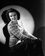 Judy Garland - Judy Garland sitting down portrait light on her +tograph High Qua...